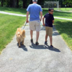 Student from Uwchlan Hills Elementary School walks a dog with Tom Richards
